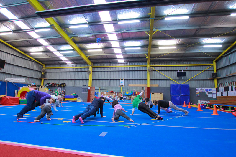 Tumble Tots balancing on their hands