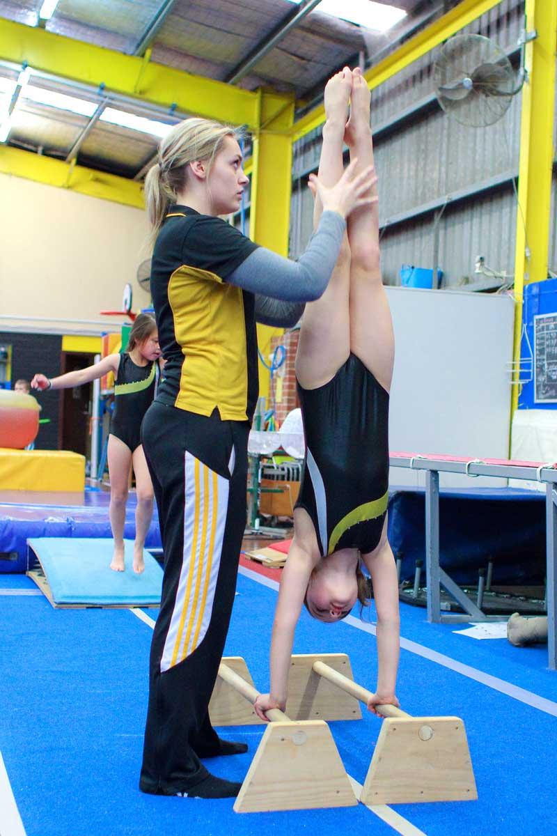 Women's Artistic Gymnastics Balancing on hands